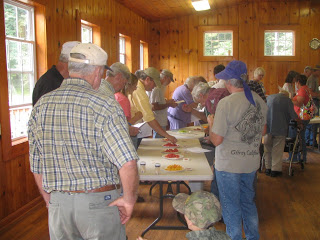 attendees participating in the tomato taste test