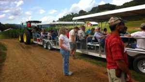 field day attendees on trailers