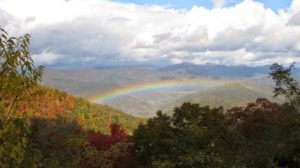 rainbow over mountain slopes