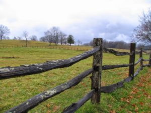 Picturesque farm scene with fence in the foreground