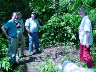 Bobbie Ammons (right) next to her bed of ramps in Cherokee County