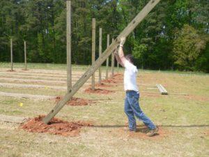 man setting a pole