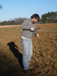 man taking soil samples