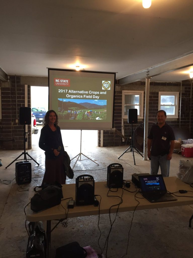 Screen, projector and speakers set up in the barn for rainy day field day