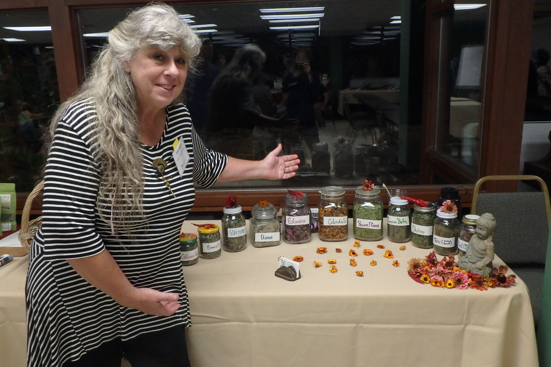 herb grower with her herb products