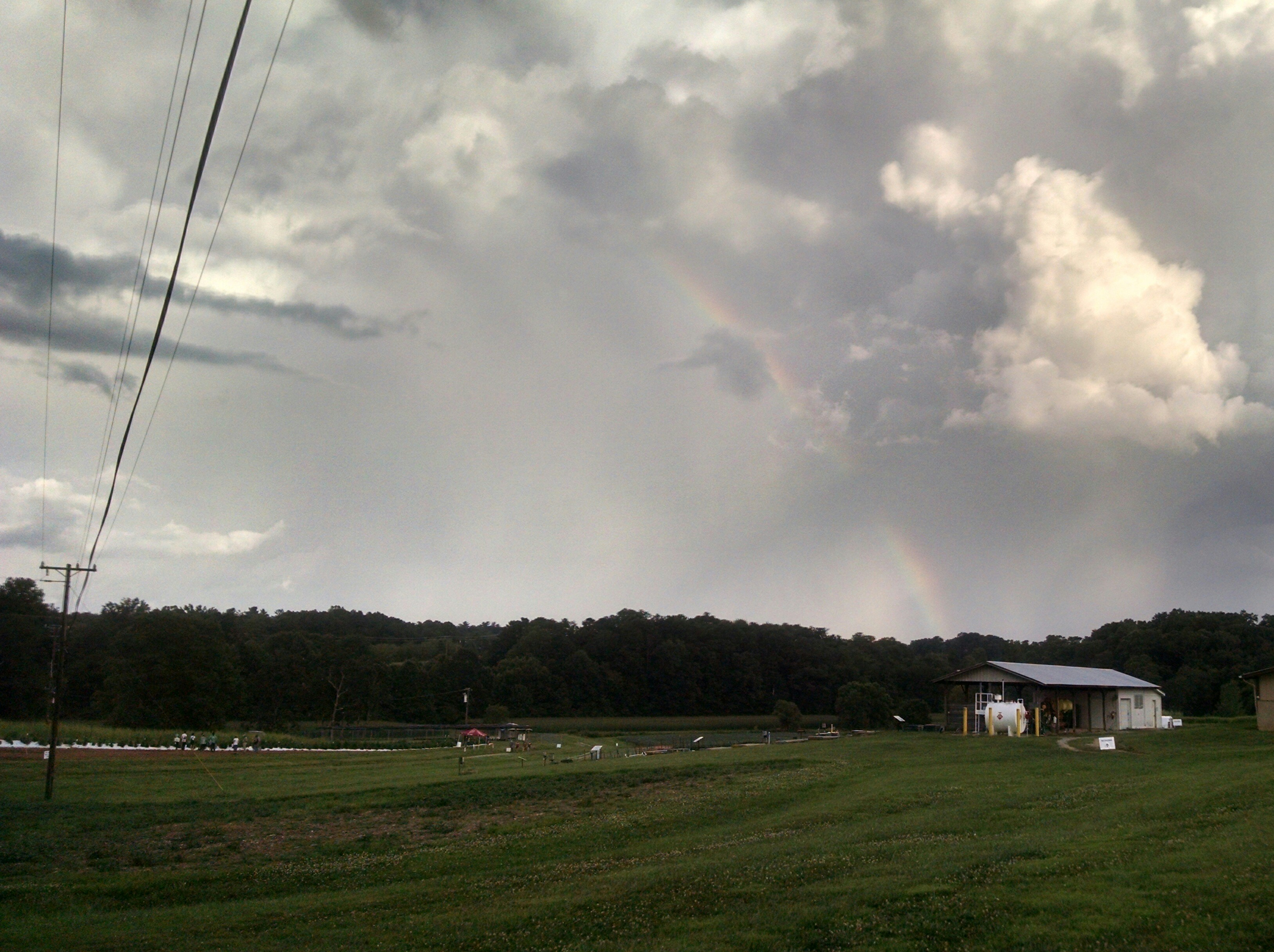 Rainbow over a field area